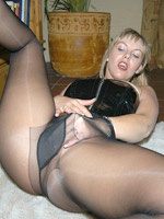Blonde mature milf in sexy black nylons showing her blowjob skills after being fingered.